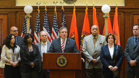 Nassau County Executive Edward P. Mangano, surrounded by