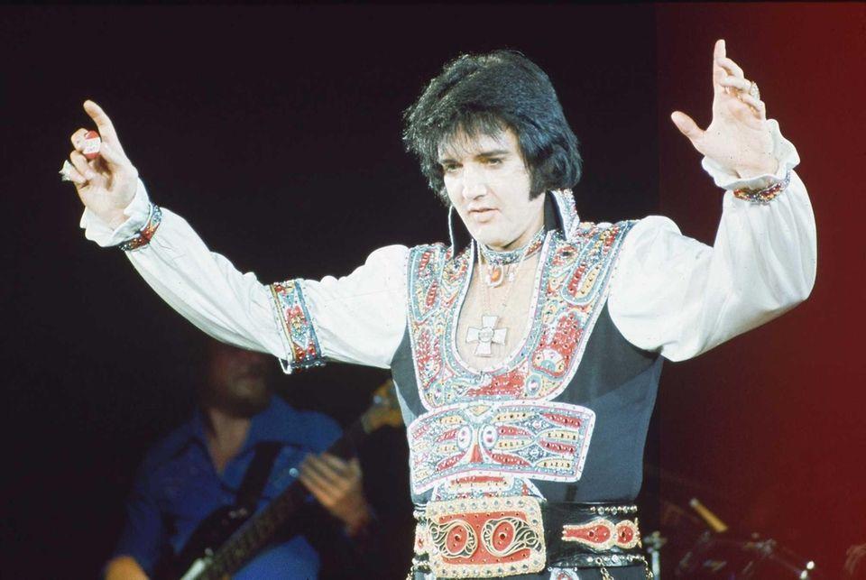 Elvis Presley performs on July 20, 1975, at