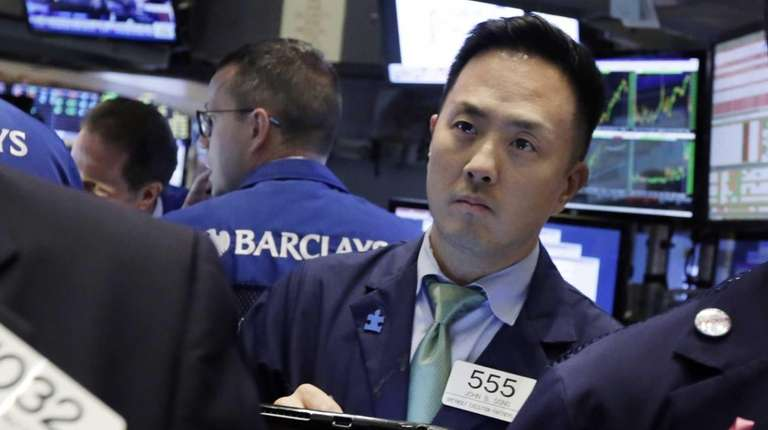 Trader John Song works on the floor of