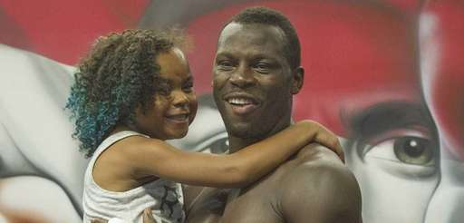 Philadelphia heavyweight boxer Steve Cunningham holds his 9-year-old