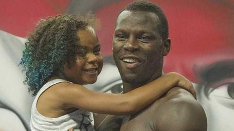 Philadelphia heavyweight boxer Steve Cunningham holds his 9-year-old