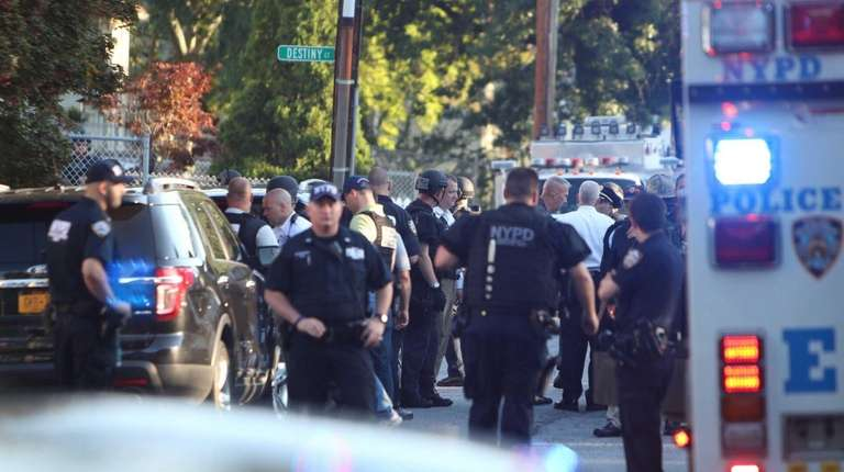 Law enforcement officers near the scene of a