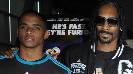 Snoop Dogg, right, poses with his son, Cordell