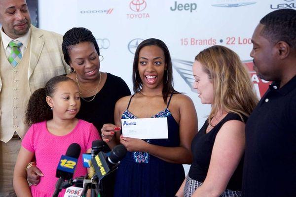 Jenell Muir, a Freeport High graduate, receives a