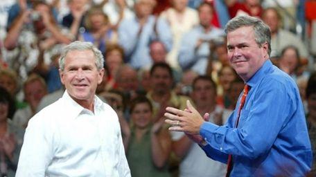 Former President George W. Bush and Jeb Bush.