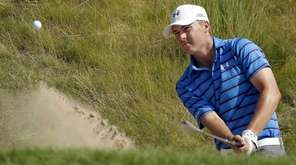 Jordan Spieth hits from a bunker on the