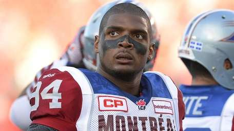 Montreal Alouettes' Michael Sam and teammates warm up