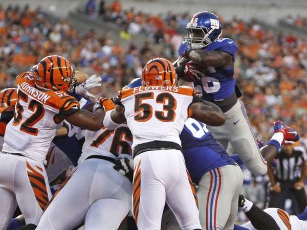 New York Giants running back Orleans Darkwa goes