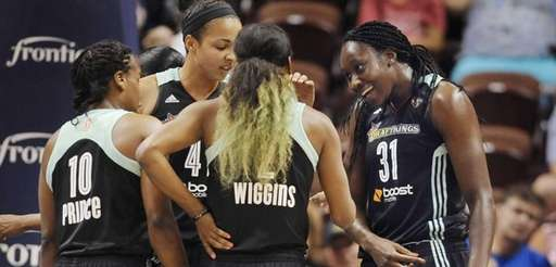 New York Liberty's Tina Charles, right, smiles as