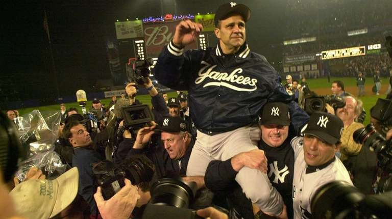 Yankees manager Joe Torre is being carried off