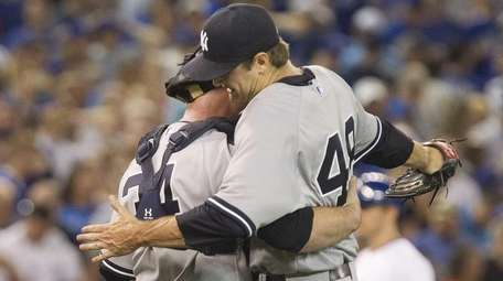 New York Yankees pitcher Andrew Miller and catcher