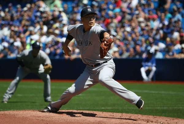 Masahiro Tanaka of the New York Yankees delivers