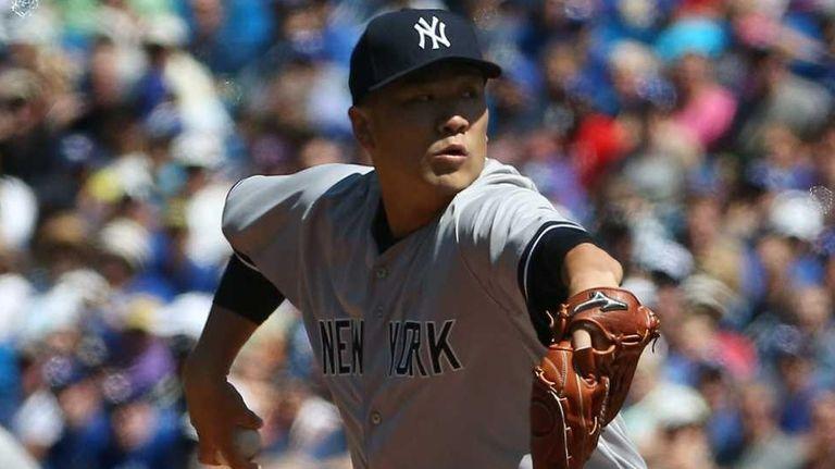 Masahiro Tanaka of the New York Yankees delivers