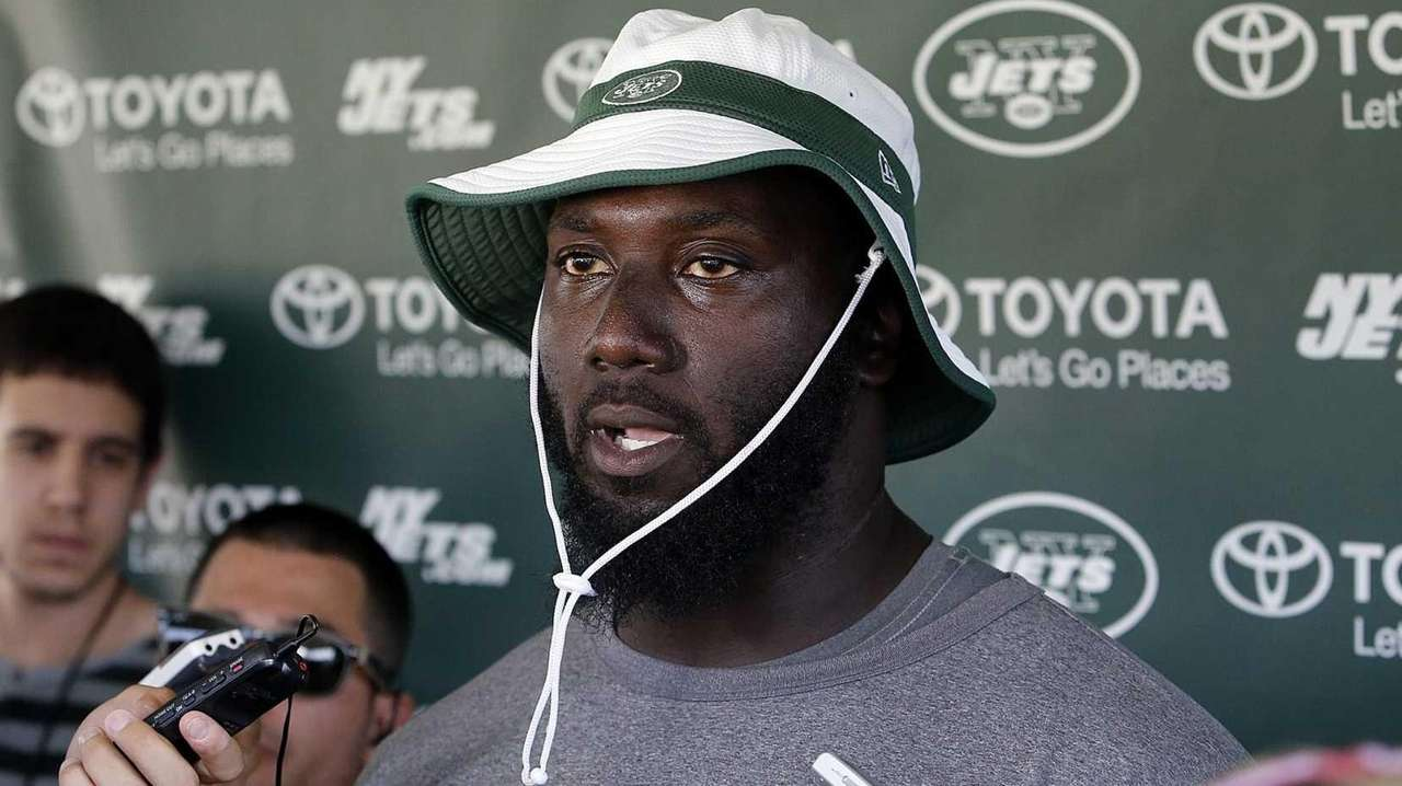 Jets defensive end Muhammad Wilkerson speaks with the