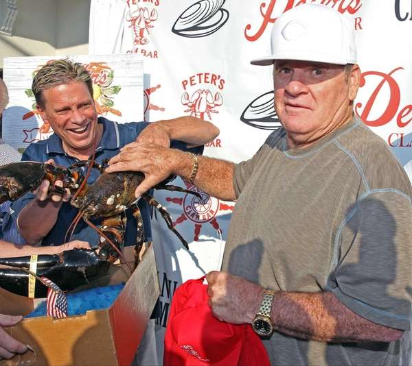 Pete Rose picks up a giant lobster as