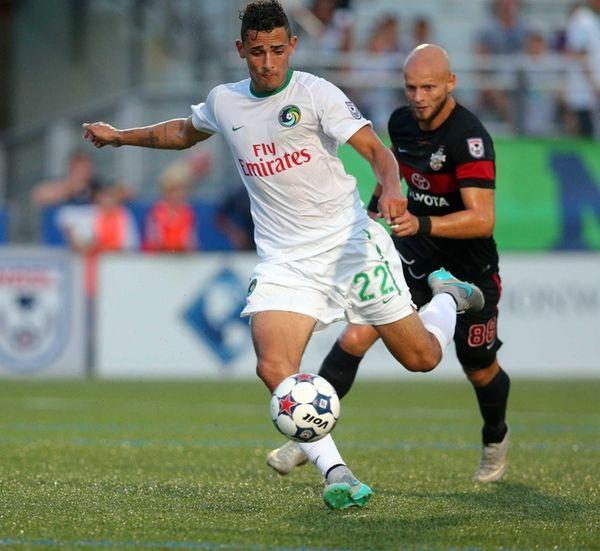 New York Cosmos midfielder Leo Fernandes taks a