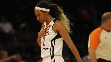 New York Liberty guard Candice Wiggins reacts after