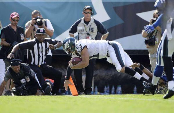 Philadelphia Eagles quarterback Tim Tebow scores a touchdown