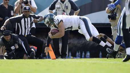 Philadelphia Eagles quarterback Tim Tebow scores a touchdown