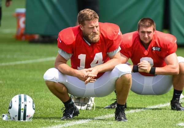 New York Jets quarterback Ryan Fitzpatrick stretches during