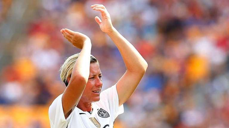 Abby Wambach #20 of the United States claps