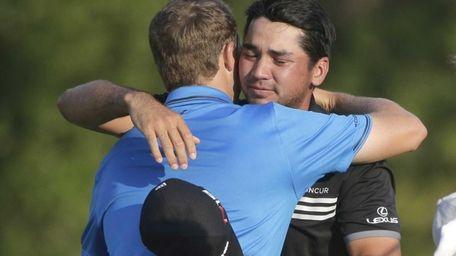Jason Day, of Australia, hugs Jordan Spieth after