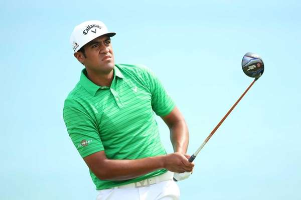 Tony Finau watches his tee shot on the