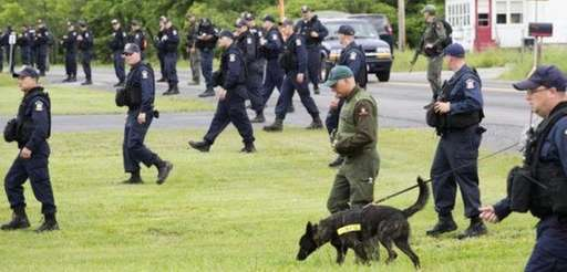 Authorities search for two escaped murderers from the