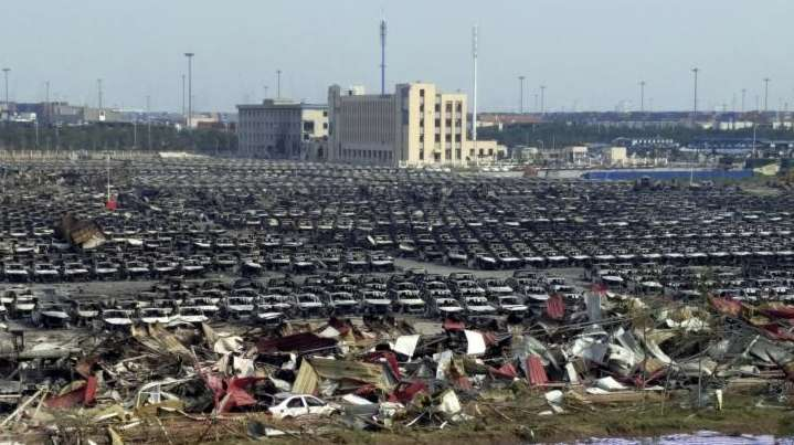 Charred remains of new cars are seen in