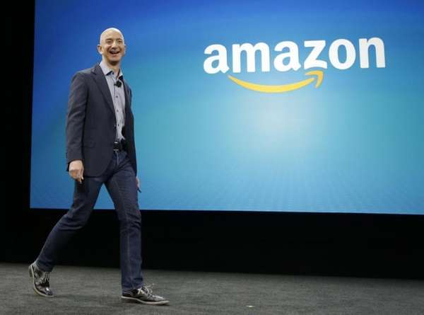 Amazon CEO Jeff Bezos walks on stage for