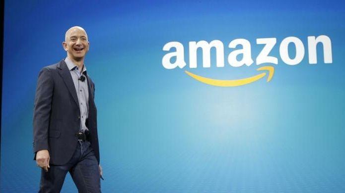Amazon CEO Jeff Bezos walks on stage for
