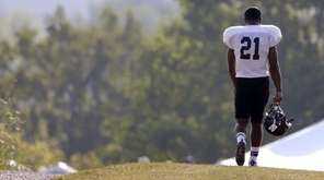 Northwestern football player Justin Jackson walks to practice