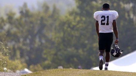 Northwestern football player Justin Jackson walks to practice