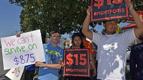 Fast-food workers and supporters rally on Wednesday morning,