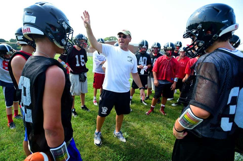 Syosset head football coach Paul Rorke directs the