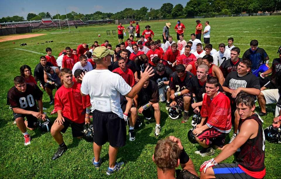 Syosset head football coach Paul Rorke addresses the