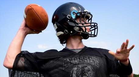 Syosset's Will Hogan throws a pass during their