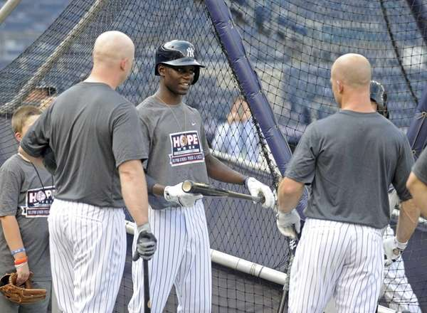 The New York Yankees' Brian McCann, left, Chris