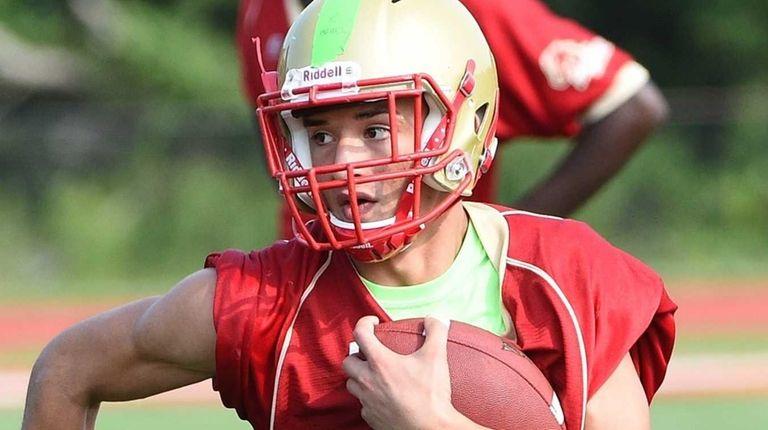 Slot back Ed Gonzalez runs with the football