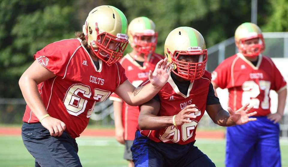 Guard Trevor Anton, left, and defensive end Isaac