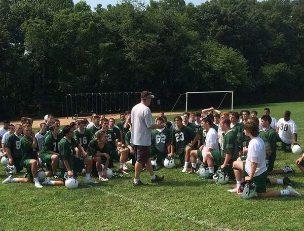Locust Valley football coach Matt McFarland addresses his