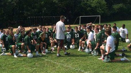 Locust Valley football coach Matt McFarland addresses his