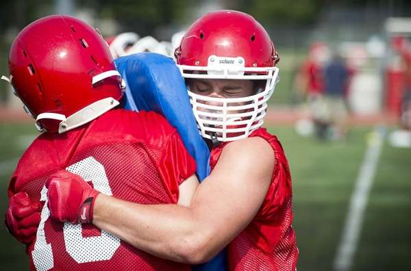 MacArthur's Sean Looney, left, and Michael Rothberg mix it up while working on their man-on-man technique during practice on Tuesday, Aug. 18, 2015.