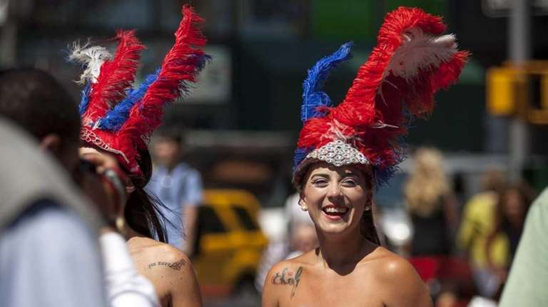Topless performers attempts to stop pedestrians to take