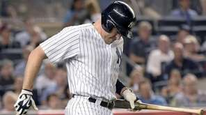 The New York Yankees' Mark Teixeira reacts after