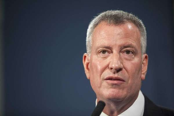 Mayor Bill de Blasio talks to the media
