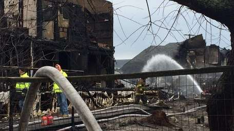 Firefighters hose down hot spots on March 27,