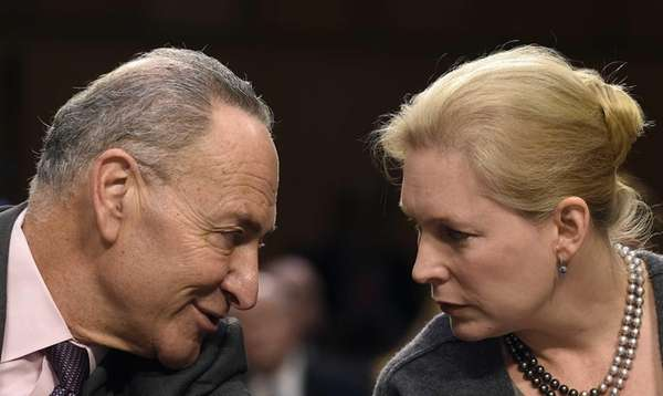 Sen. Chuck Schumer (D-N.Y.,) talks with Sen. Kirsten