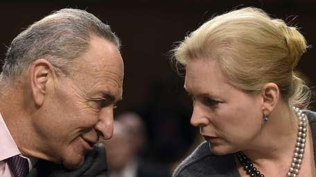 Sen. Chuck Schumer (D-N.Y.,) talks with Sen. Kirsten