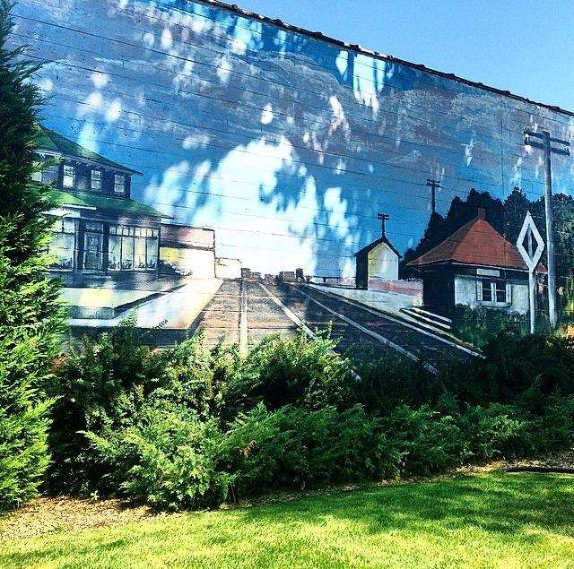 This historic railroad-themed mural can be found stretched